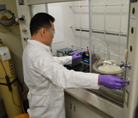 Photo of Dr. Jeff Kim working in ADA Foundation Volpe Research Center lab