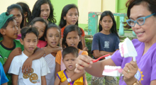 Photo of kids receiving oral health eductation in the Philippines