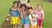 Photo of group of smiling kids in the Philippines