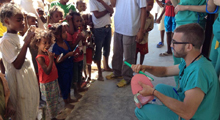 Photo of international dental volunteer providing oral health education